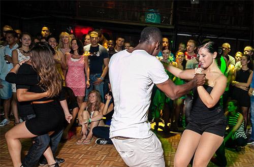 Modern Latin ballroom dance at night club